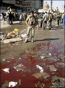 Iraqi soldier at the Ghazil market after Friday's bombing