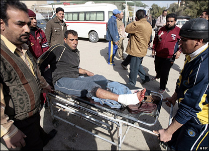 A man wounded by the blast is wheeled on a stretcher into Baghdad's al-Kindi hospital