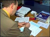head teacher at desk