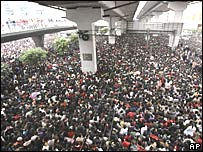 Thousands of passengers wait outside Guangzhou Railway station in south China on Friday 1 February