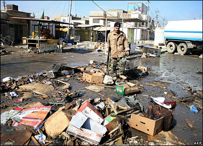 Iraqi soldier at the Jadida market after Friday's bombing