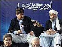 Hamid Mir, left