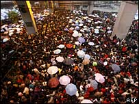 Passengers outside Guangzhou railway station, 1 February 2008