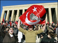 A woman waves a national flag in front of Kemal Ataturk's mausoleum in Ankara