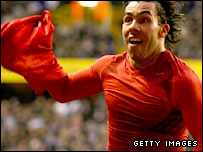 Carlos Tevez celebrates his last-gasp equaliser