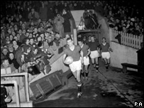 Bill Foulkes leads the makeshift United team out against Sheffield Wednesday