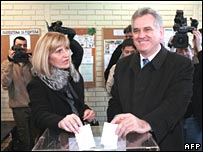 Serbian nationalist Tomislav Nikolic casts his ballot, with his wife Dragica, in Belgrade on 3 February 2008