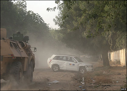 French APC and car in aftermath of fighting in Chadian capital N'Djamena