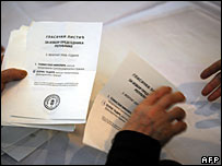 Members of an election commission count ballots after the voting ended at a polling station in Belgrade, 3 February 2008