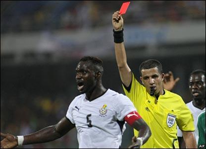 Ghana captain John Mensah is sent off