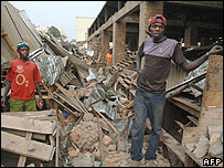 Locals stand in market destroyed by earthquake, Bukavu, DR Congo