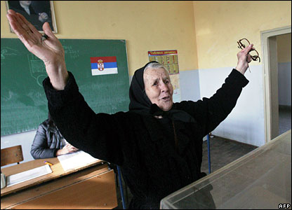 An ethnic Serb woman gestures as she votes in the Serb enclave of Gracanica, 3 February 2008