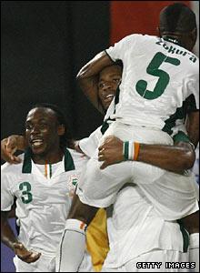Didier Drogba lifts Didier Zokora as the Ivory Coast celebrate their win