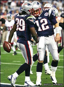 Lawrence Maroney is congratulated by quarterback Tom Brady.