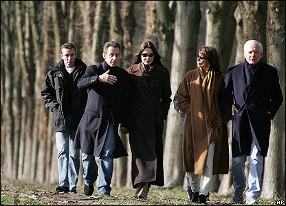 President Sarkozy and Carla Bruni (centre) walk in park of Chateau de Versailles, with Italian businessman Maurizio Remmert and his wife (right)