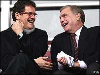 Fabio Capello (left) shares a joke with Sir Trevor Brooking