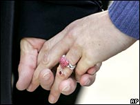 Nicolas Sarkozy and Carla Bruni hold hands (file pic)