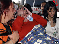 An Israeli woman injured in Monday's suicide bombing in Dimona is taken to hospital, 4 February 2008