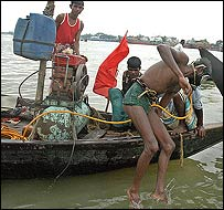 Divers at work in the Padma river