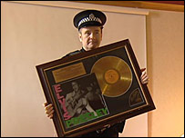 Police officer with recovered Elvis memorabilia