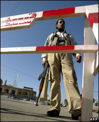 A member of the Awakening group mans a checkpoint in Baghdad's Al-Adhamiyah district  (file photo)