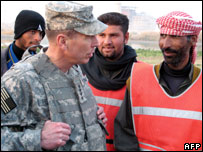 US commander General David Petraeus (L) talks to members of Concerned Local Citizens  (file photo)