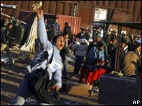 A Palestinian throws a stone at the Rafah border crossing between Egypt and Gaza, 4 February 2008