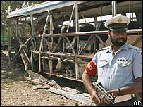Policeman by the scene of the bus bombing, Sargodha 1 Nov 2007
