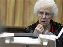 A lady using an electronic voting machine