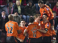 Darren Dods is mobbed after his first half equaliser