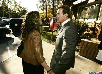 California�s Governor Arnold Schwarzenegger and first lady Maria Shriver say goodbye and go their separate ways after casting their votes at Kenter Canyon Charter Elementary School.
