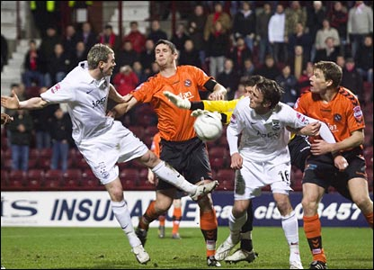 Dundee United's Lee Wilkie (centre) and Darren Dods (right) tussle with Zander Diamond (left) and  Lee Miller at bay