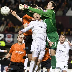 Keeper Jamie Langfield (right) commands his Aberdeen area
