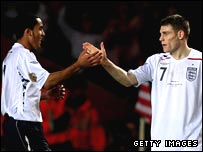 Theo Walcott and James Milner