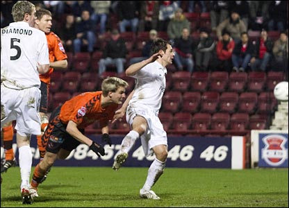 Christian Kalvenes (centre) sends Dundee United ahead with a diving header