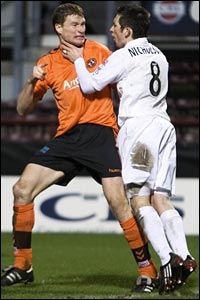 Aberdeen's Barry Nicholson (right) clashes with Darren Dods after believing he was impeded in the box by the United defender
