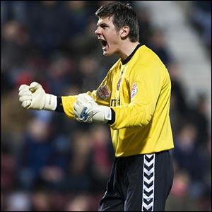 Goalkeeper Lukasz Zaluska celebrates Dundee United's emphatic victory