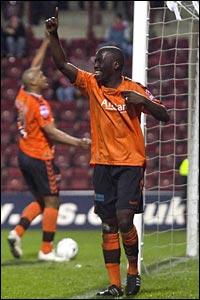 Morgaro Gomis celebrates scoring Dundee United's fourth of the match