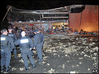 Police survey the damage to the Hickory Ridge Mall in Memphis, Tennessee