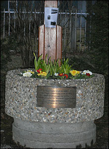 Another memorial in the village of Kirchtrudering where the crash actually occured is decorated with a trough filled with flowers