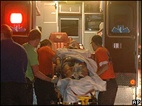 A student is transferred into an ambulance after being pulled from a collapsed dormitory building at Union University, Tennessee,.