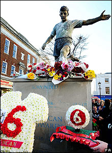 Hundreds of floral tributes are laid at the memorial for Duncan Edwards