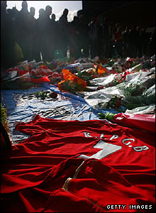 Hundreds of tributes including shirts and scarfs are left at Old Trafford