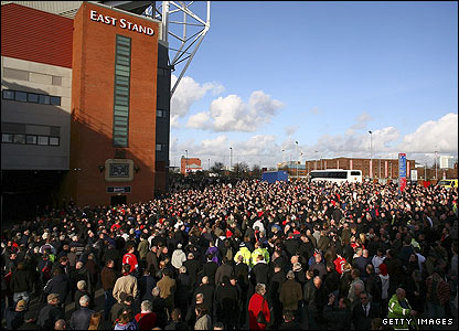 Fans observe the minute's silence at Old Trafford