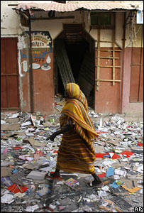 Resident walks through the destroyed central market in N'Djamena, Chad