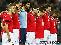 England's team observe a minute's silence before the game against Switzerland at Wembley