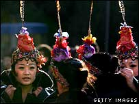 Performers prepare for a traditional New Year dance in Beijing