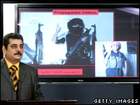 Iraq's ministry of defence spokesman Mohammed al-Askari stands near a video on a screen during a press conference in Baghdad, Iraq, on 6 February 2008