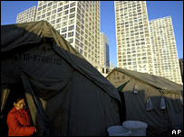 A woman living in a tent near skyscrapers in Beijing, China (2007)