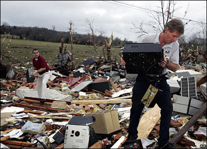 US Post Office workers search through the remains of a post office in Castalian Springs, Tennessee